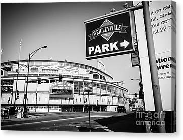 Wrigley Field And Wrigleyville Signs In Black And White Canvas Print by Paul Velgos