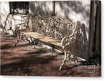 Wrought Iron Bench In White Canvas Print by Jennifer Apffel