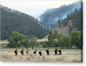 Canvas Print featuring the photograph Wyoming Hot Shots Walk To Their Assignment by Bill Gabbert