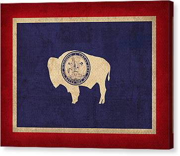 Wyoming State Flag Art On Worn Canvas Canvas Print by Design Turnpike