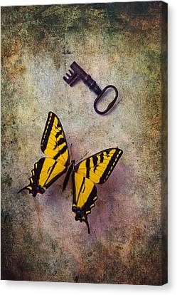 Yellow Butterfly With Key Canvas Print by Garry Gay