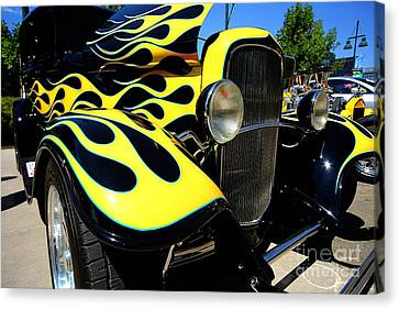 Yellow Flames Canvas Print by Cheryl Young