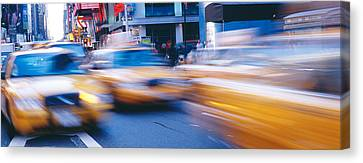 Yellow Taxis On The Road, Times Square Canvas Print by Panoramic Images