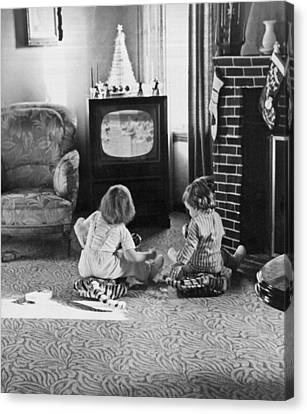 Young Children Watching Tv Canvas Print by Underwood Archives