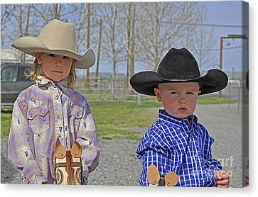 Young Cowboy And Cowgirl Stick Ponies Canvas Print by Valerie Garner