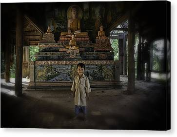 Young Khmer Boy At Old Temple Canvas Print by David Longstreath