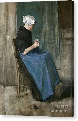 Young Scheveningen Woman Knitting Facing Right Canvas Print by Vincent van Gogh