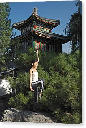 A Chinese Woman In Her 20s To 30s Doing Canvas Print by Justin Guariglia