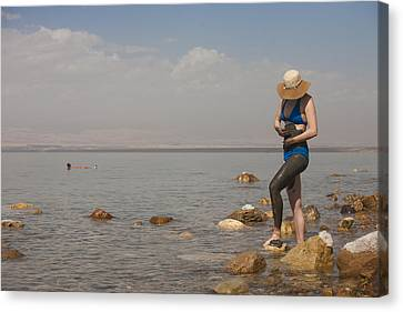 A Woman Smears Therapeutic Dead Sea Mud Canvas Print by Taylor S. Kennedy