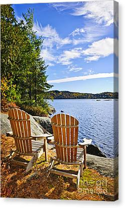 Adirondack Chairs At Lake Shore Canvas Print by Elena Elisseeva