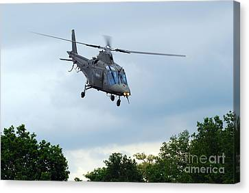 An Agusta A109 Helicopter Canvas Print by Luc De Jaeger