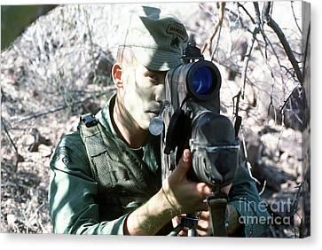 An Army Ranger Sets Up An Anpaq-1 Laser Canvas Print by Stocktrek Images