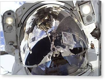 Astronaut Uses A Digital Still Camera Canvas Print by Stocktrek Images