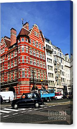 Busy Street Corner In London Canvas Print by Elena Elisseeva