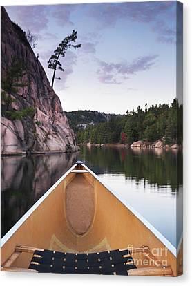 Canoeing In Ontario Provincial Park Canvas Print by Oleksiy Maksymenko