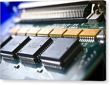 Circuit Board Components Canvas Print by Arno Massee
