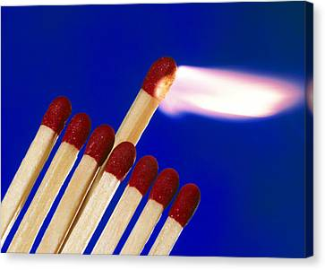 Close-up Of A Set Of Matches Igniting Canvas Print by Tek Image