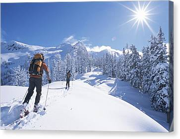 Cross-country Skiers In The Selkirk Canvas Print by Jimmy Chin