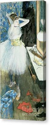 Dancer In Her Dressing Room Canvas Print by Edgar Degas