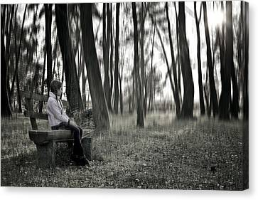 Girl Sitting On A Wooden Bench In The Forest Against The Light Canvas Print by Joana Kruse