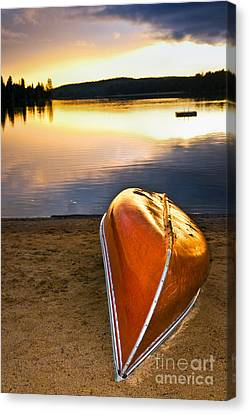 Lake Sunset With Canoe On Beach Canvas Print by Elena Elisseeva