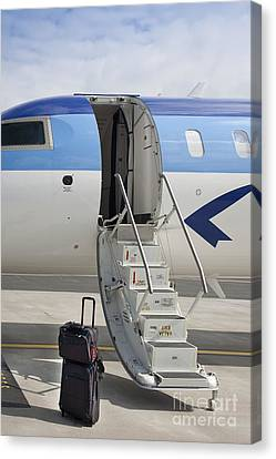 Luggage Near Airplane Steps Canvas Print by Jaak Nilson