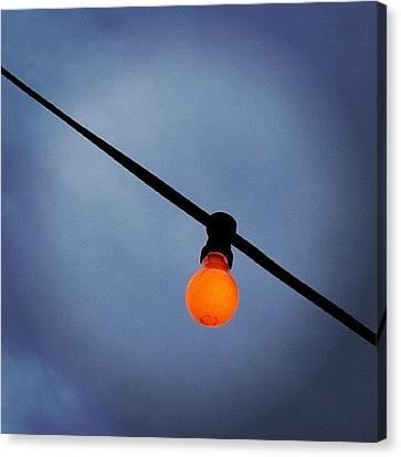 Orange Light Bulb Canvas Print by Matthias Hauser