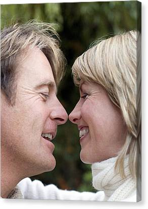 Smiling Couple Embracing Canvas Print by Ian Boddy