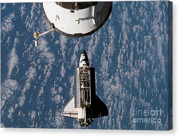 Space Shuttle Atlantis Approaching Canvas Print by Stocktrek Images