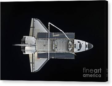 Space Shuttle Atlantis Backdropped Canvas Print by Stocktrek Images
