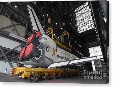 Space Shuttle Atlantis Rolls Canvas Print by Stocktrek Images
