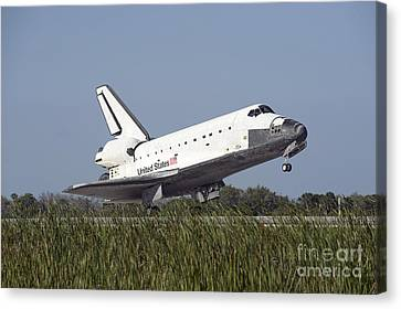 Space Shuttle Atlantis Touches Canvas Print by Stocktrek Images