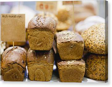 Stacks Of Fresh Bread For Sale Canvas Print by Hybrid Images
