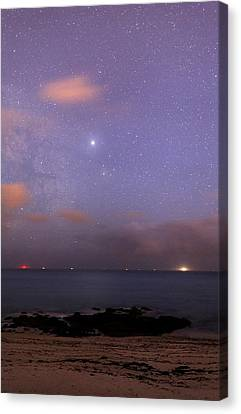 Stars And Jupiter In A Night Sky Canvas Print by Laurent Laveder