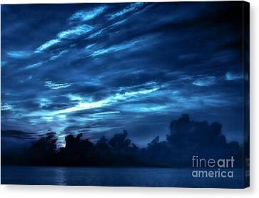 Sunrise In Blue Canvas Print by Jeff Breiman