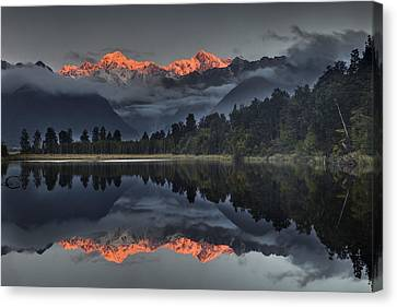Sunset Reflection Of Lake Matheson Canvas Print by Colin Monteath