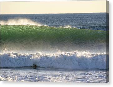Surfing During A December Swell Canvas Print by Rich Reid