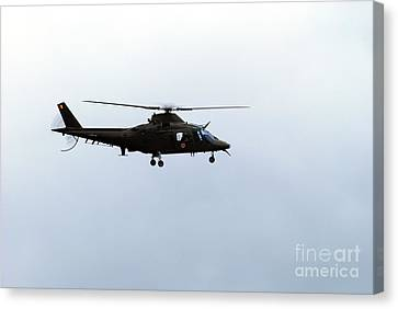 The Agusta A-109 Helicopter Canvas Print by Luc De Jaeger