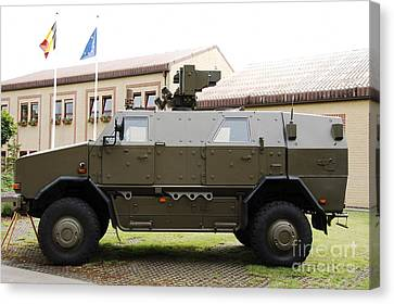 The Multi-purpose Protected Vehicle Canvas Print by Luc De Jaeger