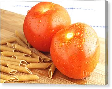 Tomatoes And Pasta Canvas Print by Blink Images