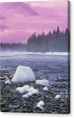 Winter Sunset On Bow River, Banff Canvas Print by Darwin Wiggett