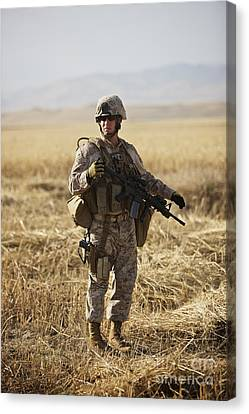 U.s. Marine Patrols A Wadi Near Kunduz Canvas Print by Terry Moore