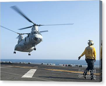 A Ch-46e Sea Knight Helicopter Prepares Canvas Print by Stocktrek Images