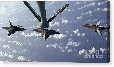 A Three Ship Formation Of F-22 Raptors Canvas Print by Stocktrek Images