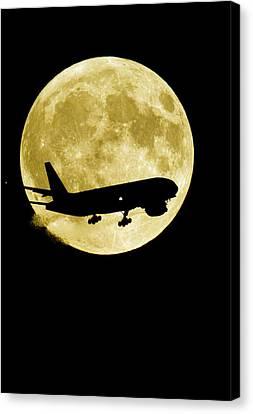 Aeroplane Silhouetted Against A Full Moon Canvas Print by David Nunuk