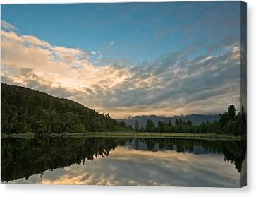 Sunrise Above A Lake On A Wind Still Morning Canvas Print by Ulrich Schade
