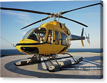 A Bell 407 Utility Helicopter Canvas Print by Terry Moore