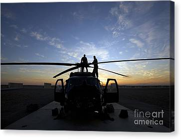 A Uh-60 Black Hawk Helicopter Canvas Print by Terry Moore