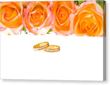 4 Red Yellow Roses And Wedding Rings Over White Canvas Print by Ulrich Schade