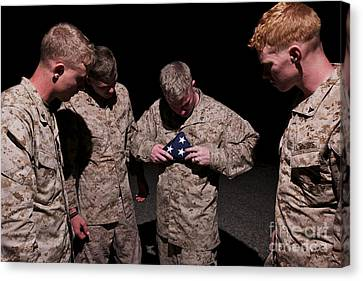 U.s. Marines Fold The American Flag Canvas Print by Terry Moore